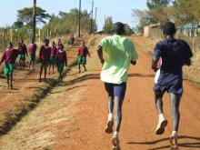 James Koskei and Timothy Cherigat run a hard 25K in Iten, with a little help from their friends.