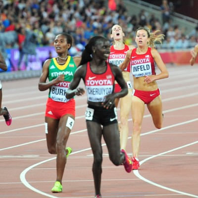 Vivian Cheruiyot and Gelete Burka enjoy the moment as Emily lunges for 3rd
