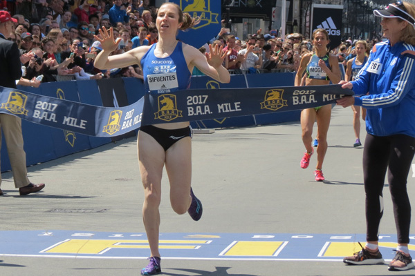 Nicole Sifuentes breaks the tape in course-record time at the BAA Mile. Photo by Jane Monti/Race Results Weekly.