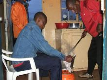 It's gotta be the food, right? John Yuda and Peter Tanui prepare ugali.