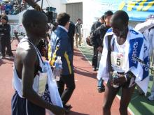 Charles, smiling, with winner Edwin Komen after the race