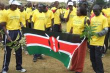 Douglas Wakihuri (1987 world marathon champ) and Luke Kibet (2007 world marathon champ) with their country's flag.